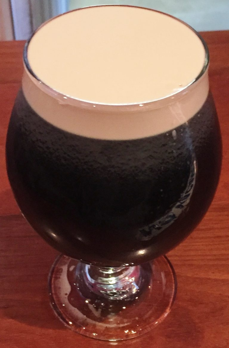 Snifter of stout poured on Nitro.